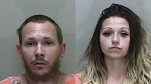 Drug house with drive-thru window raided, two arrested